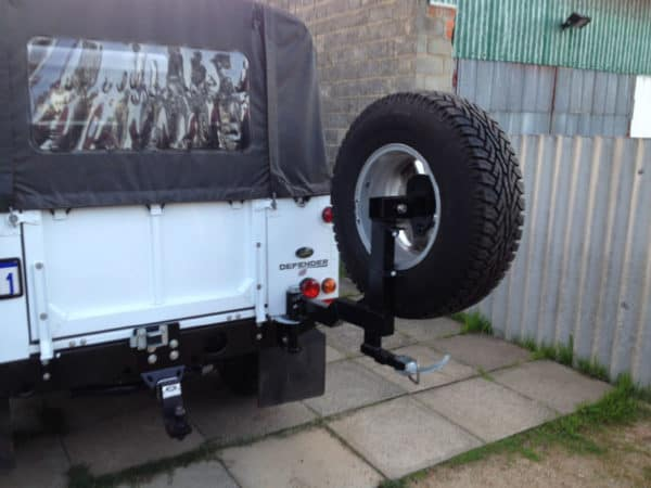 Defender single spare wheel carrier for drop-down tailgate.